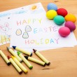 Kid drawing and eggs for easter holiday — Stock Photo