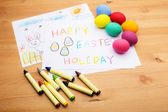 Kid drawing and eggs for easter holiday — Stok fotoğraf
