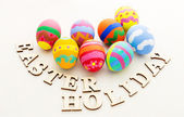 Easter eggs and wooden text — Stockfoto