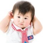 Asian Baby girl touching her ears — Stock Photo #43230787