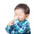 Asian baby boy stuck a finger in his mouth — Stock Photo #43278257