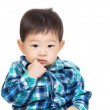 Asian baby boy stuck finger into his mouth — Stock Photo #43278563