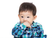 Asian baby boy suck his finger — Stock Photo