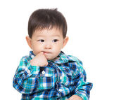 Asian baby boy stuck finger into mouth — Stock Photo