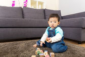 Asian little boy play toy block at home — Stock Photo