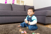Asian little boy play toy block — Foto de Stock