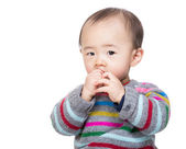 Asian baby boy suck finger — Stock Photo