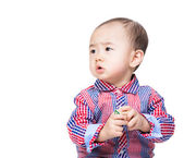 Asian baby holding toy block and looking aside — Stock fotografie