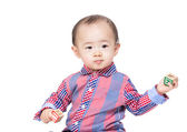 Asian baby boy holding toy block — Stock Photo