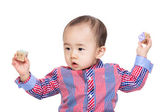 Asian baby boy raised his hands up with toy blocks — Stockfoto