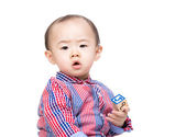 Asian little boy play with toy block — Stock Photo