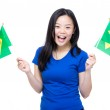 Asian woman holding Brazil flags — Stock Photo #43798531