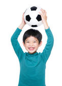 Asian little boy holding up his soccer ball — Foto de Stock