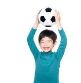 Asian little boy holding up his soccer ball — Stock Photo