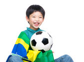 Asian little boy with brazil flag and soccer ball — Zdjęcie stockowe