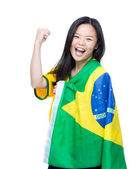 Excited asian woman draped with Brazil flag — Stock Photo