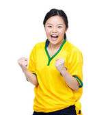 Excited asian female football supporter — Stock Photo