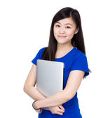 Asian woman holding computer — Stock Photo