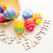 Colourful design easter eggs with wooden word — Stock Photo