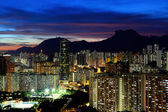 Kowloon cityscape in Kong Kong with lion rock mountain — Stock Photo