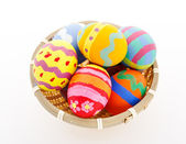 Colourful painted easter eggs in basket — Stockfoto