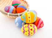 Colourful easter eggs in basket — Stockfoto