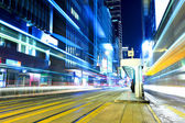 Busy traffic with tram stop in Hong Kong city — Stockfoto