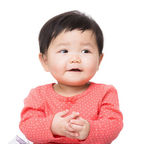 Asian baby girl clapping hand — Stock Photo