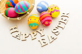 Painted easter eggs in basket — Stock Photo