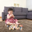 Asian little girl playing toy blocks at home — Stock Photo