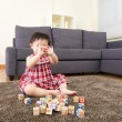Asian little girl playing toy blocks at home — Stock Photo #44938203