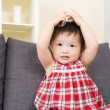 Asian baby girl play toy blocks and sitting on sofa — Stock Photo #44938267