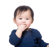 Asian baby girl suck finger into mouth — Stock Photo