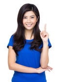 Happy Asian woman pointing up with her finger — Stock Photo