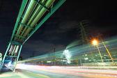 Industrial factory with traffic trail at night — Stock Photo