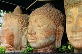 Carved buddha stone statue — Stock Photo