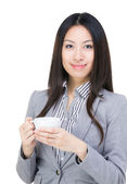 Asian businesswoman holding coffee cup — Foto Stock