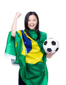Excited asian soccer fan — Stock Photo