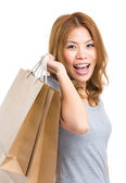 Smiling woman with shopping bag — Stock Photo