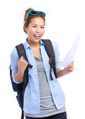 Happy travel woman holding information — Foto Stock