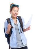 Happy travel woman holding information — Stock Photo