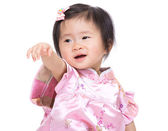 Chinese babby girl hand up and point to front — Stock Photo