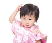 Chinese baby girl feeling confuse — Stock Photo