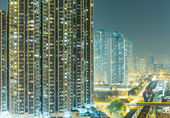 Apartment block in Hong Kong at night — Stock Photo