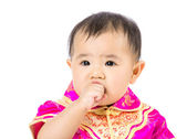 Chinese baby girl suck finger into mouth — Stock Photo