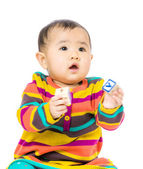 Asia baby holding toy block — Stock Photo