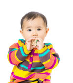 Asia baby girl suck wooden toy block — Stock Photo