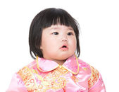 Baby wearing cheongsam suit for Chinese New Year — Stock Photo