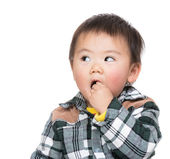 Little boy biting finger and looking aside — Stock Photo