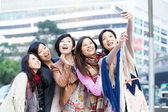Young female friends taking selfie in Hong Kong — Stockfoto